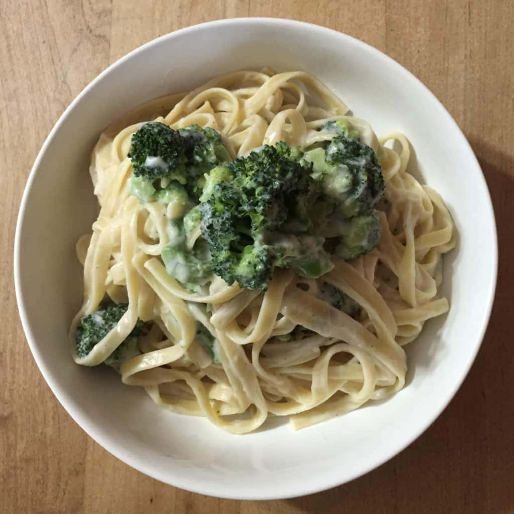vegan no oil creamy cauliflower alfredo sauce with linguini by very veganish