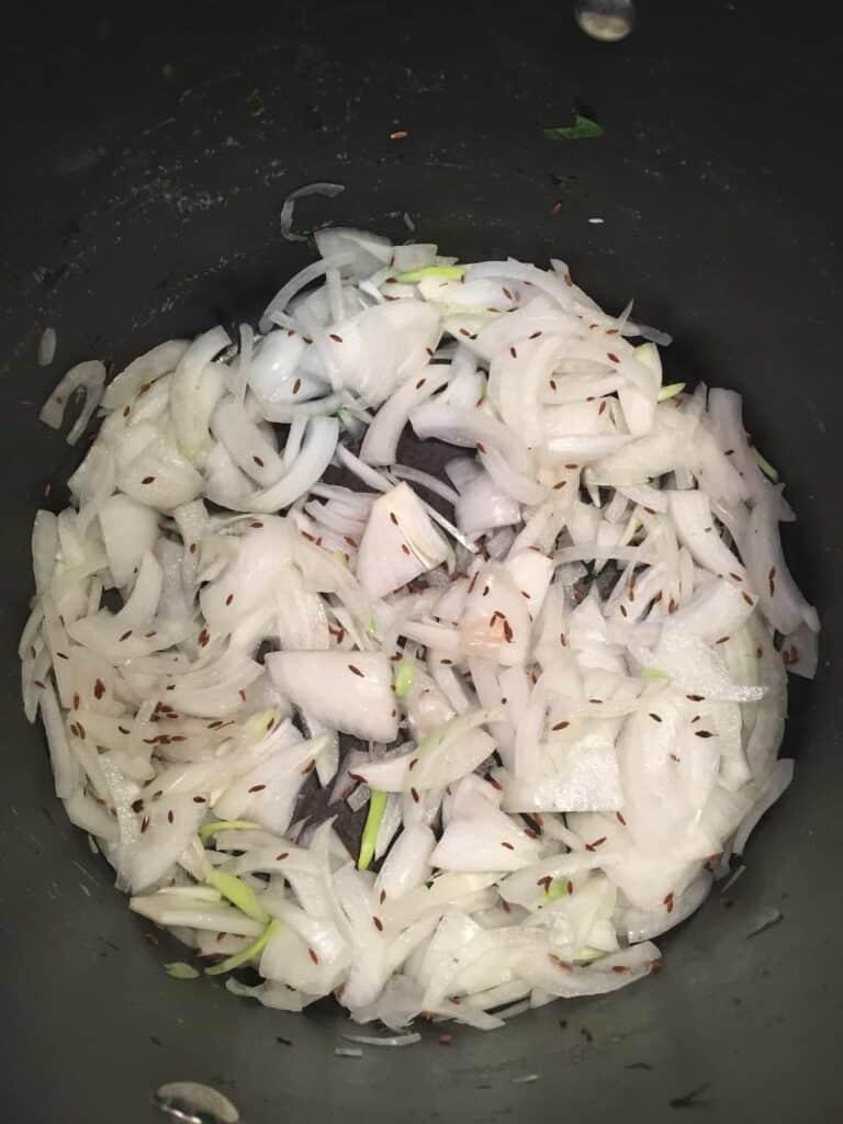 vegan saag paneer onions cooking