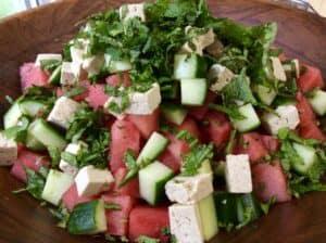Fresh Herbs, Marinated Tofu, Juicy Watermelon and Crisp Cucumber Salad. Watermelon, Cucumber, Tofu Feta, Basil, Mint Salad by Very Veganish