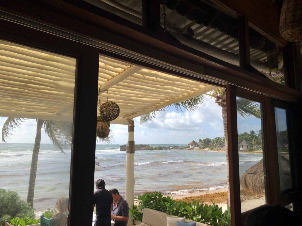 beach and ocean view at el pez hotel tulum restaurant for breakfast before going to coba