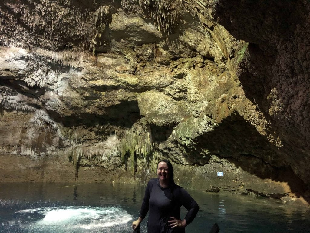 swimming and diving in cenote tankach-ha coba yucatan mexico