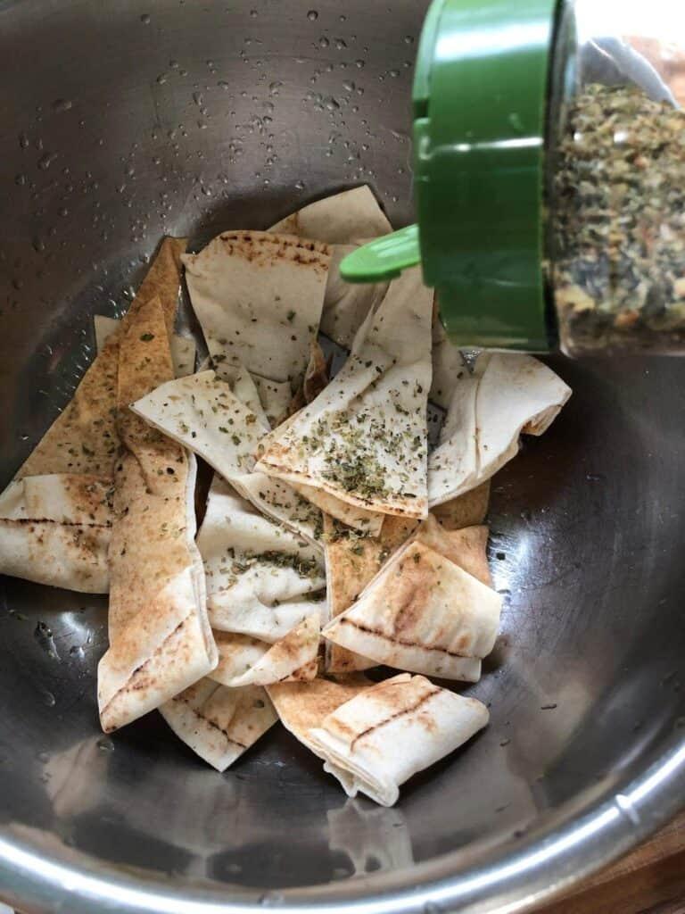 sprinkling zohrab's greek seasoning