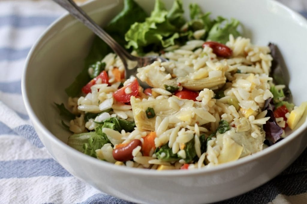 orzo salad in white bowl