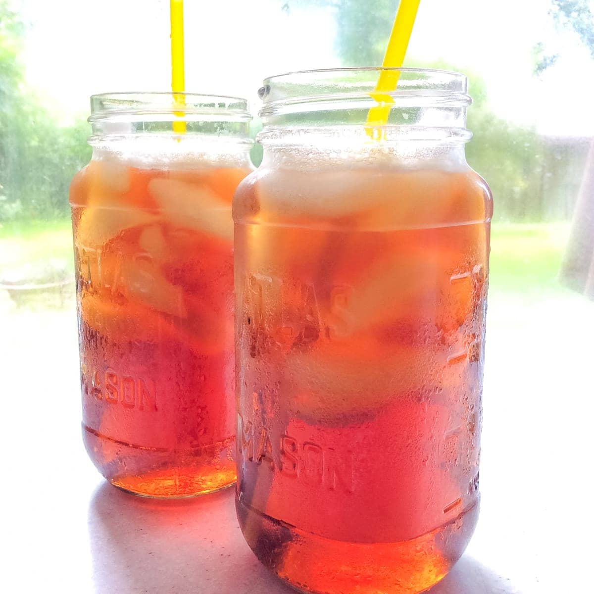 two glasses with straws