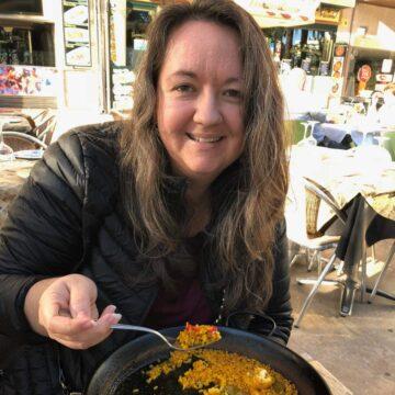 Abi Cowell eating paella in Spain