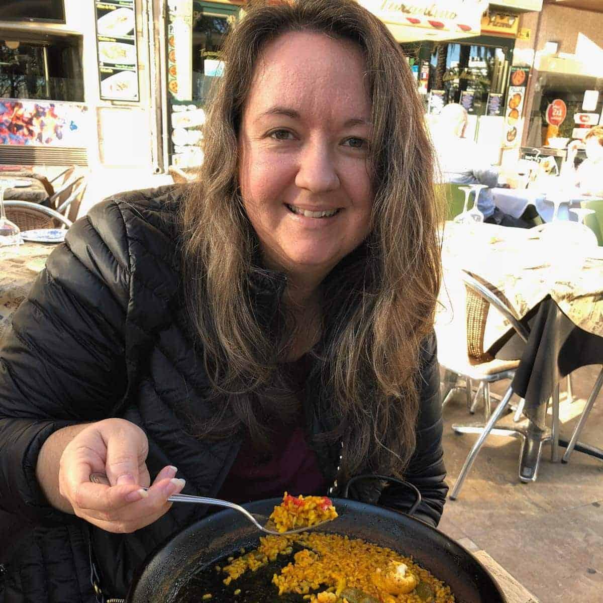 woman eating paella