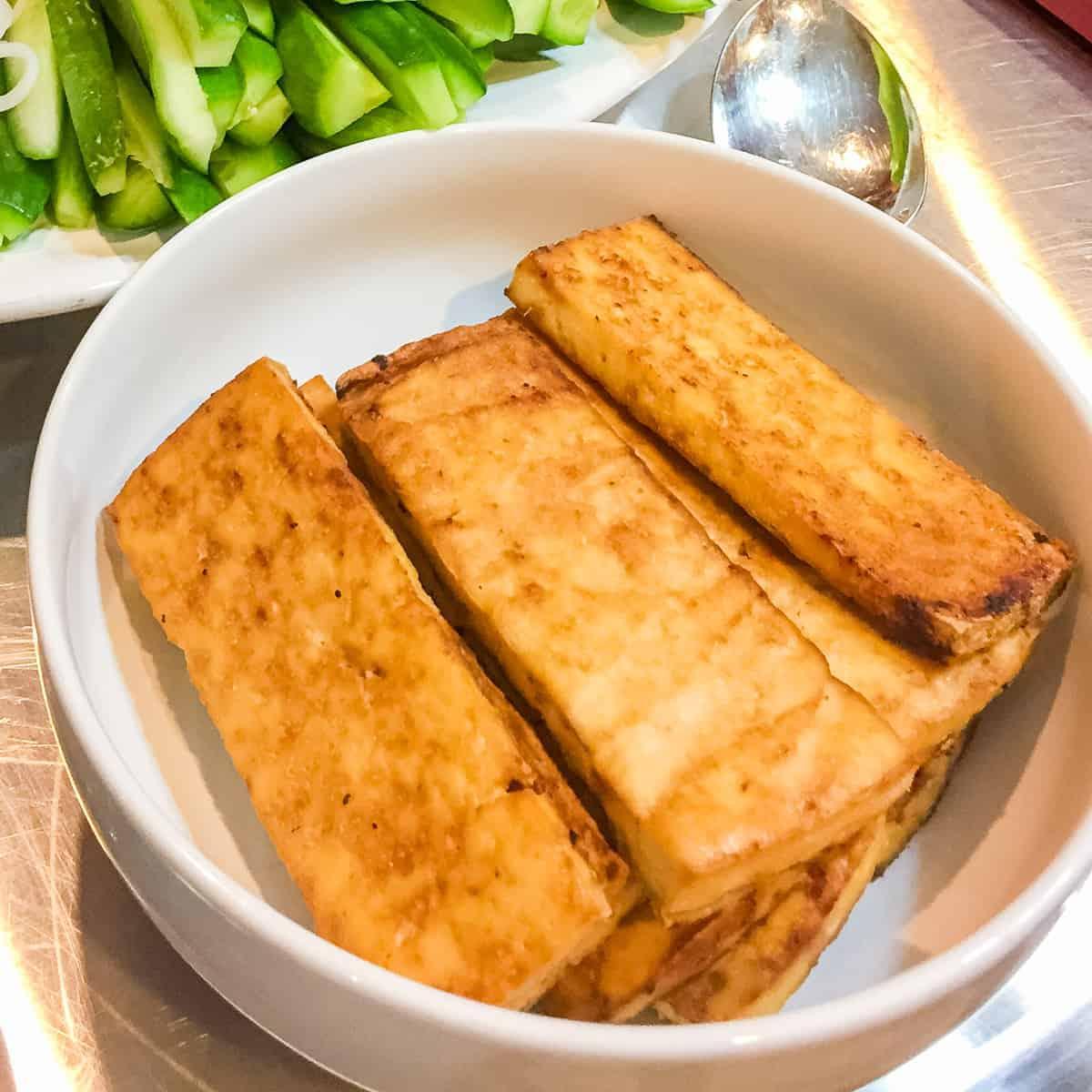 tofu in white bowl