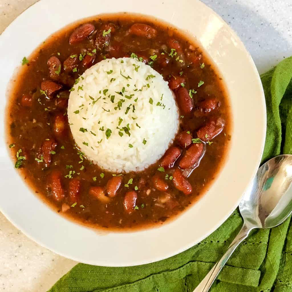 bowl of beans and rice with spoon