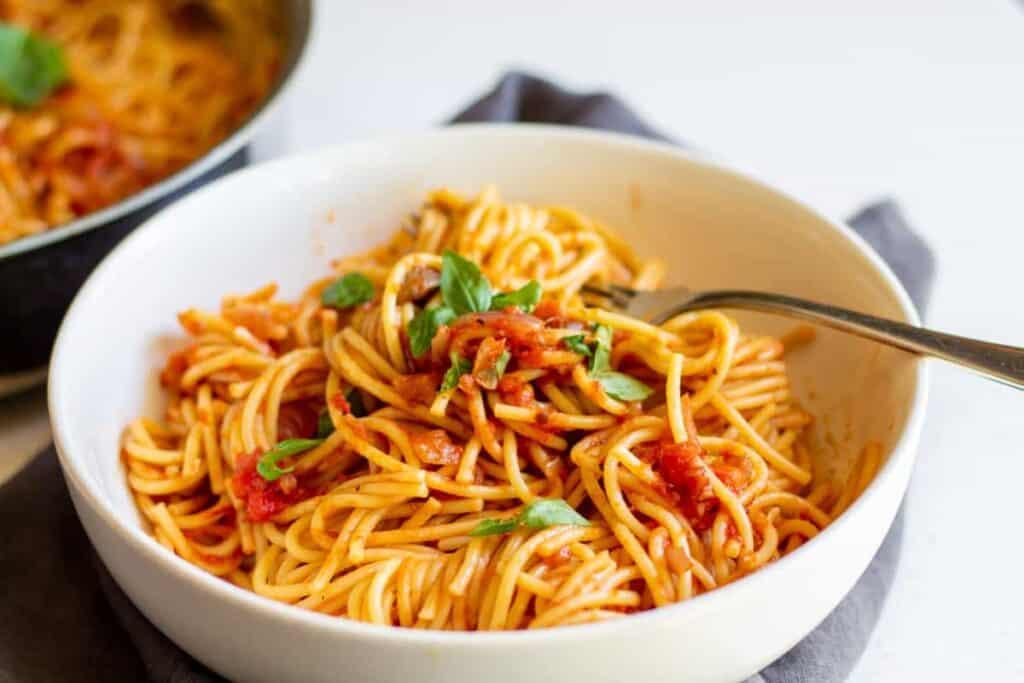 fork digging into spaghetti
